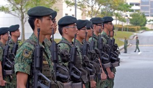 A platoon of Singapore infantry soldiers stand at attention as they await the arrival of Maj. Gen. Patrick Wilson, Deputy Commanding General, Army National Guard, United States Army Pacific (USARPAC), in Singapore, July 16. Wilson was visiting members of Operation Tiger Balm 09, a coalition training exercise between the Singapore Army, and citizen-soldiers and citizen-airmen from Ore., Hawaii, Utah and Ariz.   (U.S. Army photo by Sgt. Eric A. Rutherford, 115th Mobile Public Affairs Detachment.)