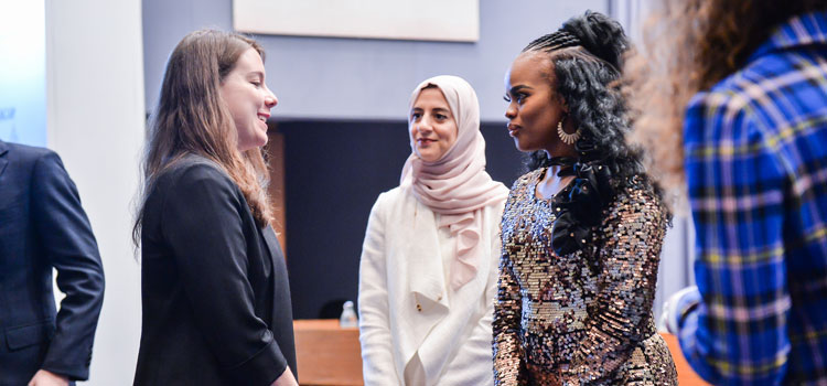 Partner representative chatting with Her Royal Highness Princess Sikhanyiso of Eswatini and Her Excellency Huda Al Hashimi of the UAE.